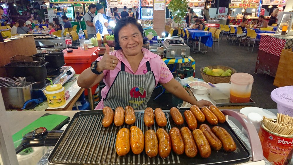 smiling-thai-lady-with-sausages
